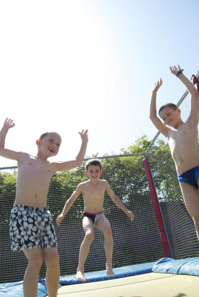 fun on the trampoline at Camping Fuussekaul Heiderscheid Luxembourg