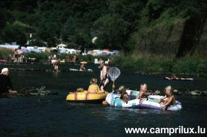 enjoy playing in the water and with inflatable boats in the river Sûre next tp Camping Um Gritt Bourscheid Moulin Luxembourg
